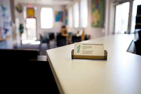 Photo of Intersect's business cards on front desk